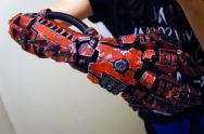 Design by me, mask and gauntlet are both made of hand painted foam and electronics.