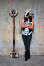 """63"""" Double-headed bone polearm with shoulder blade axe heads, made with composite foam wrapped around a hybrid core, coated in latex."""
