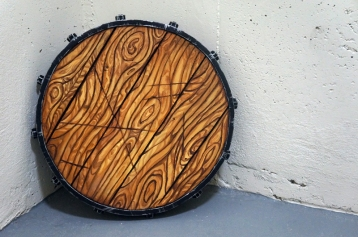 "A 15"" plastidipped buckler with engraved wood grain - LARP safe."