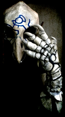 EL Wire, Apoxie Sculpt, foam and glue make up this bone outfit.